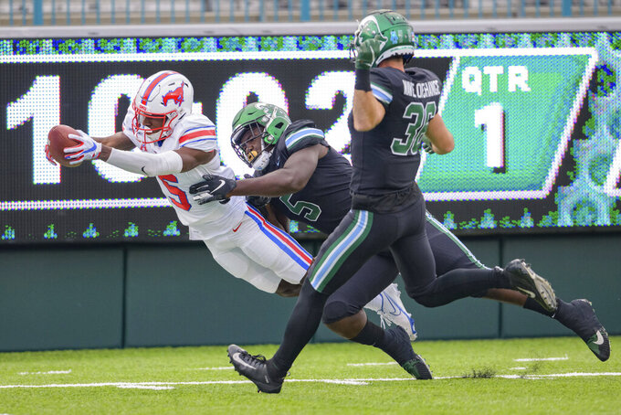 SMU wide receiver Danny Gray, left, scores a touchdown in the first half against Tulane defensive end Cameron Sample, center, during an NCAA college football game in New Orleans, Friday, Oct. 16, 2020. (AP Photo/Matthew Hinton)