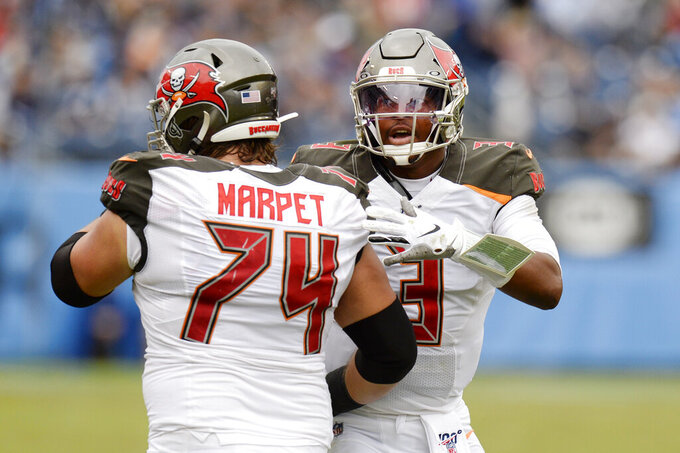 Tampa Bay Buccaneers quarterback Jameis Winston (3) celebrates with offensive guard Ali Marpet (74) after the Buccaneers scored a touchdown against the Tennessee Titans in the second half of an NFL football game Sunday, Oct. 27, 2019, in Nashville, Tenn. (AP Photo/Mark Zaleski)
