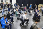 FILE - In this March 24, 2020, file photo journalists practice social distancing during a news conference with New York Gov. Andrew Cuomo at the Jacob Javits Center that will house a temporary hospital in response to the COVID-19 outbreak in New York. (AP Photo/John Minchillo, File)
