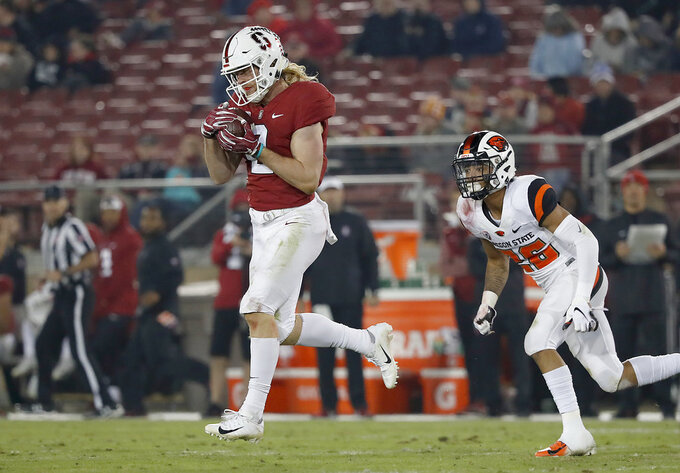 Stanford wide receiver Trenton Irwin (2) catches a pass past Oregon State cornerback Jaydon Grant (26) in the second half during an NCAA college football game on Saturday, Nov. 10, 2018, in Stanford, Calif. (AP Photo/Tony Avelar)