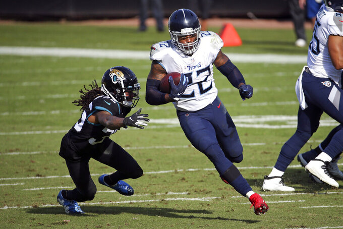 Tennessee Titans running back Derrick Henry (22) goes past Jacksonville Jaguars cornerback Sidney Jones for a 36-yard touchdown during the first half of an NFL football game, Sunday, Dec. 13, 2020, in Jacksonville, Fla. (AP Photo/Stephen B. Morton)