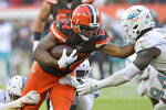 Cleveland Browns running back Nick Chubb (24) rushes for a 5-yard touchdown during the second half of an NFL football game against the Miami Dolphins, Sunday, Nov. 24, 2019, in Cleveland. (AP Photo/David Richard)
