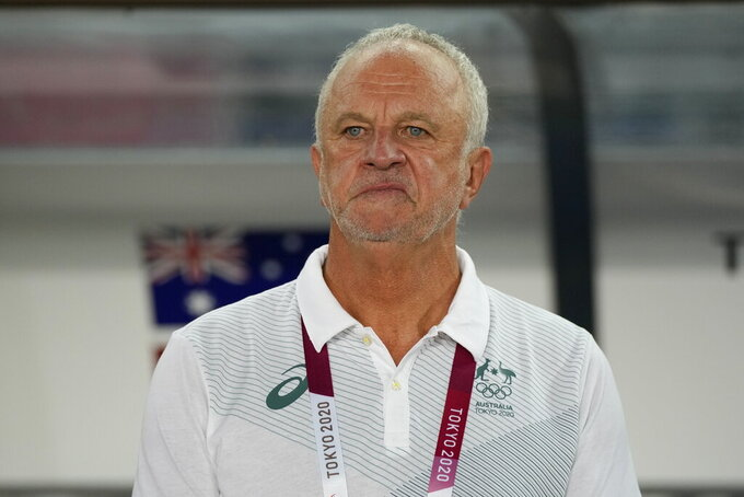 Australia's coach Graham Arnold stands pro a match against Egypt during a men's soccer match at the 2020 Summer Olympics, Wednesday, July 28, 2021, in Sendai, Japan. (AP Photo/Andre Penner)