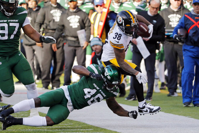 Pittsburgh Steelers cornerback Mike Hilton (28) runs with the ball past New York Jets linebacker Neville Hewitt (46) in the first half of an NFL football game, Sunday, Dec. 22, 2019, in East Rutherford, N.J. (AP Photo/Seth Wenig)
