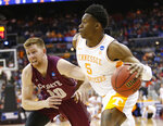 Tennessee's Admiral Schofield (5) drives past Colgate's Will Rayman (10) in the first half of a first-round game in the NCAA men's college basketball tournament in Columbus, Ohio, Friday, March 22, 2019. (AP Photo/Paul Vernon)