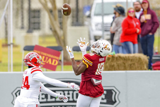 Louisiana-Monroe wide receiver Jonathan Hodoh (18) makes a reception against Louisiana-Lafayette safety Bralen Trahan (24) in the first half of an NCAA college football game in Monroe, La., Saturday, Nov. 28, 2020. (AP Photo/Matthew Hinton)