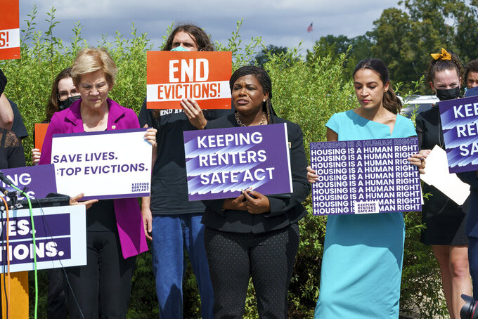 From left, Sen. Elizabeth Warren, D-Mass., Rep. Cori Bush, D-Mo., and Rep. Alexandria Ocasio-Cortez, D-N.Y., and other progressive lawmakers advocate for reimposing a nationwide eviction moratorium that lapsed last month, at the Capitol in Washington, Tuesday, Sept. 21, 2021. (AP Photo/J. Scott Applewhite)