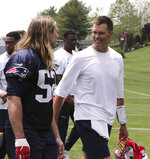 New England Patriots quarterback Tom Brady, right, talks with New England Patriots defensive lineman Chase Winovich (52) after an NFL football training camp in Foxborough, Mass., Wednesday, June 5, 2019. (AP Photo/Charles Krupa)
