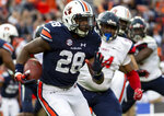 Auburn running back JaTarvious Whitlow (28) breaks loose for a long run against Liberty during the first half of an NCAA college football game, Saturday, Nov. 17, 2018, in Auburn, Ala. (AP Photo/Vasha Hunt)