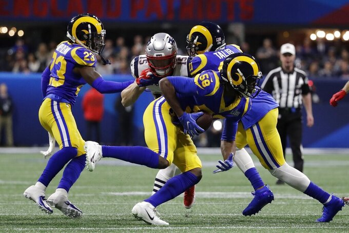 Los Angeles Rams' Cory Littleton (58) intercepts a pass intended for New England Patriots' Chris Hogan (15), during the first half of the NFL Super Bowl 53 football game Sunday, Feb. 3, 2019, in Atlanta. (AP Photo/Jeff Roberson)