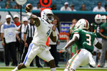 Central Connecticut State quarterback Romelo Williams (4) passes as Miami safety Gilbert Frierson (3) defends during the first half of an NCAA college football game, Saturday, Sept. 25, 2021, in Miami Gardens, Fla. (AP Photo/Lynne Sladky)