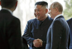 Russian President Vladimir Putin, right, and North Korea's leader Kim Jong Un shake hands during their meeting in Vladivostok, Russia, Thursday, April 25, 2019. At his first summit with Russian President, North Korean leader Kim shows off confident side, an apparently chronic problem with breathlessness and a knack for manspreading. (AP Photo/Alexander Zemlianichenko, Pool)