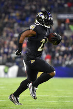 Baltimore Ravens running back Mark Ingram runs for a touchdown against the New York Jets during the first half of an NFL football game, Thursday, Dec. 12, 2019, in Baltimore. (AP Photo/Gail Burton)