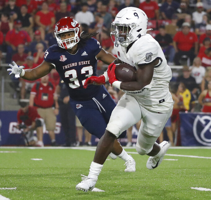 UNLV running back Charles Williams heads downfield against Fresno State during the first half of an NCAA college football game in Fresno, Calif., Friday, Sept. 24, 2021. (AP Photo/Gary Kazanjian)