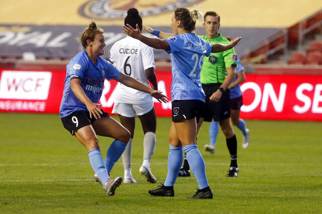 Chicago Red Stars' Bianca St. George (29) celebrates with teammate Savannah McCaskill (9) after scoring against the Sky Blue during the first half of an NWSL Challenge Cup soccer semifinal match Wednesday, July 22, 2020, in Sandy, Utah. (AP Photo/Rick Bowmer)
