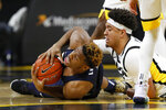 Oral Roberts forward Elijah Lufile, left, fights for the ball with Iowa forward Cordell Pemsl during the first half of an NCAA college basketball game, Friday, Nov. 15, 2019, in Iowa City, Iowa.(AP Photo/Charlie Neibergall)