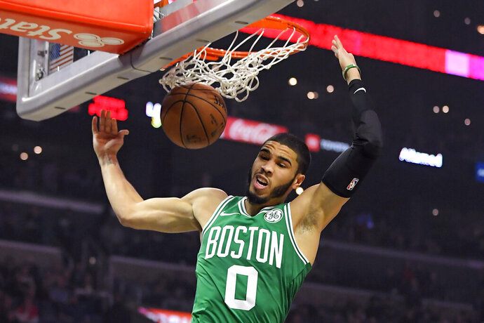 Boston Celtics forward Jayson Tatum dunks during the first half of the team's NBA basketball game against the Los Angeles Clippers on Wednesday, Nov. 20, 2019, in Los Angeles. (AP Photo/Mark J. Terrill)