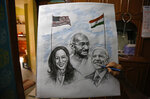 An Indian artist Aejaz Saiyed gives finishing touch to an art work featuring U.S.President-elect Joe Biden, Vice President-elect Kamala Harris  and Indian freedom fighter Mahatma Gandhi, ahead of Biden's inauguration ceremony, in Ahmedabad, India, Wednesday, Jan. 20, 2021. The inauguration of Biden and Harris is scheduled be held Wednesday. (AP Photo/Ajit Solanki)