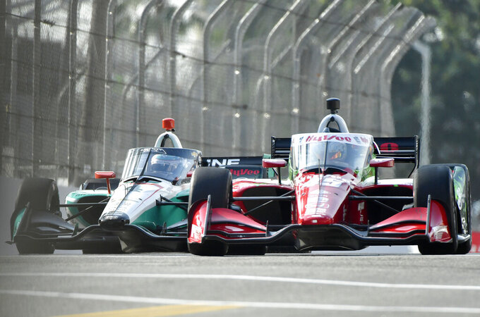 IndyCar drivers Dalton Kellett, left, from Stouffville, Canada, and Graham Rahal, from New Albany, Ohio, race up Pine Avenue during the final practice session at the Acura Grand Prix of Long Beach, Saturday, Sept. 25, 2021, in Long Beach, Calif. (Will Lester/The Orange County Register via AP)