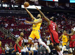 Golden State Warriors' Ky Bowman (12) goes up for a shot as Houston Rockets' James Harden (13) defends during the first half of an NBA basketball game Wednesday, Nov. 6, 2019, in Houston. (AP Photo/David J. Phillip)