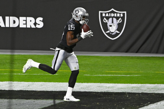 Las Vegas Raiders wide receiver Nelson Agholor (15) catches a pass for a touchdown against the Kansas City Chiefs during the first half of an NFL football game, Sunday, Nov. 22, 2020, in Las Vegas. (AP Photo/David Becker)