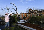 In this Tuesday, March 3, 2020 photo, Ann Hooven and her granddaughter Caroline Hooven survey the damage at their home on Hunters Hill Rd. after a tornado ripped through the Donelson neighborhood of Nashville, Tenn. (George Walker IV/The Tennessean via AP)
