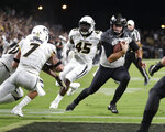FILE - In this Sept. 15, 2018, file photo, Purdue quarterback David Blough (11) runs in for a touchdown past Missouri safety Cam Hilton (7) and defensive lineman Franklin Agbasimere (45) during the first half of an NCAA college football game in West Lafayette, Ind. The David Blough-led offense has not been a problem, but the defense has been abysmal. And the Boilers will be playing a Boston College team that is hot, having scored 40-plus points in three straight games. (AP Photo/Michael Conroy, File)