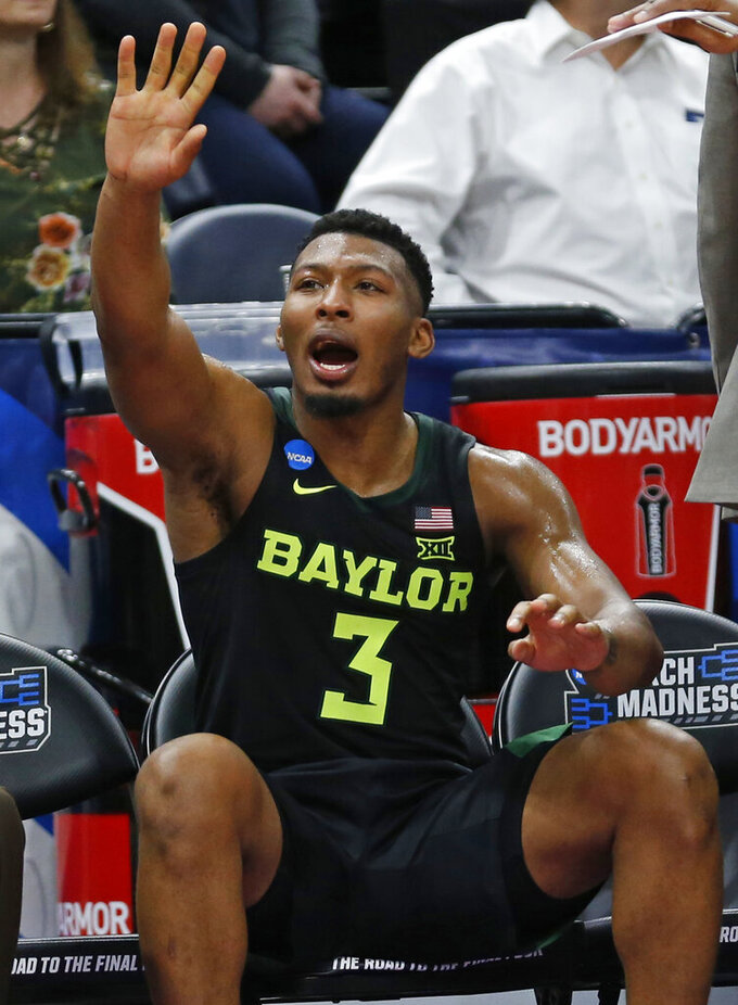 Baylor guard King McClure celebrates as he sits on the bench during the second half of the team's first-round game against Syracuse in the NCAA men's college basketball tournament Thursday, March 21, 2019, in Salt Lake City. (AP Photo/Rick Bowmer)