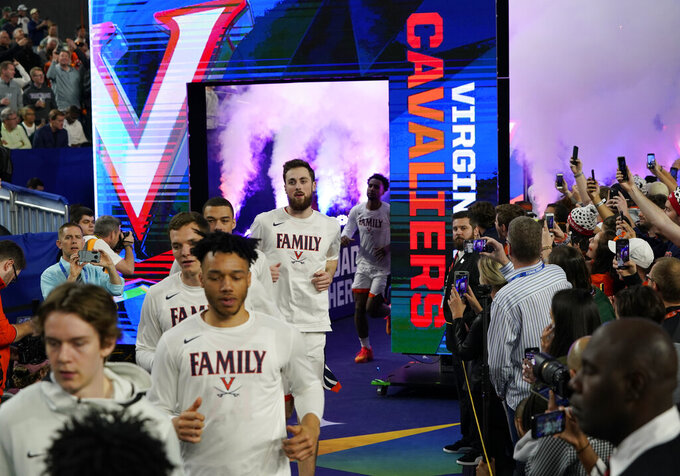 Virginia players arrive on the court before the semifinals of the Final Four NCAA college basketball tournament against Auburn, Saturday, April 6, 2019, in Minneapolis. (AP Photo/David J. Phillip)