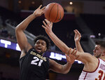 Southern California forward Nick Rakocevic, right, knocks the ball from the hands of Colorado forward Evan Battey during the first half of an NCAA college basketball game Saturday, Feb. 9, 2019, in Los Angeles. (AP Photo/Mark J. Terrill)