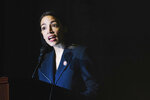 Rep. Alexandria Ocasio-Cortez, D-N.Y., delivers her inaugural address following her swearing-in ceremony at the Renaissance School for Musical Theater and Technology in the Bronx borough of New York on Saturday, Feb. 16, 2019. (AP Photo/Kevin Hagen)