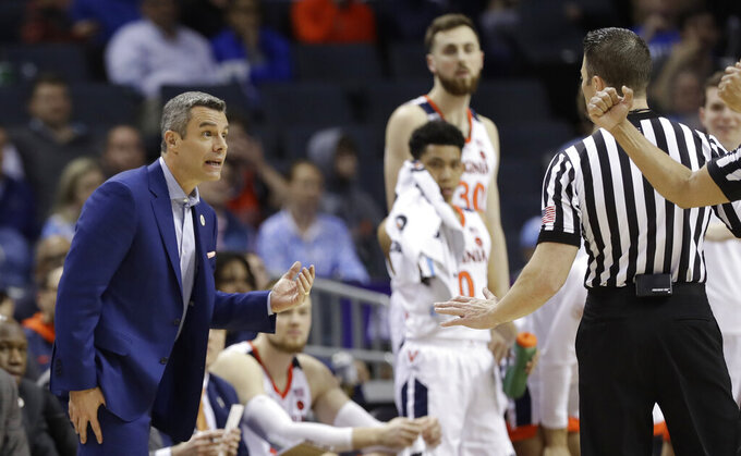 Virginia coach Tony Bennett discusses a call with an official during the second half of an NCAA college basketball game against Florida State in the Atlantic Coast Conference tournament in Charlotte, N.C., Friday, March 15, 2019. (AP Photo/Chuck Burton)