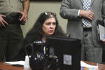 Louise Turpin sits in a courtroom during a sentencing hearing Friday, April 19, 2019, in Riverside, Calif. Turpin and her husband, David, who pleaded guilty to years of torture and abuse of 12 of their 13 children have been sentenced to life in prison with possibility of parole after 25 years. (Will Lester/The Orange County Register via AP, Pool)