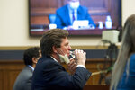 Securities and Exchange Commission (SEC) Chairman Jay Clayton drinks water as he testifies before a House Committee on Financial Services hearing on Financial Services Capital Markets and Emergency Lending in the COVID-19 Era on Capitol Hill in Washington on Thursday, June 25, 2020. (Rod Lamkey/Pool via AP)
