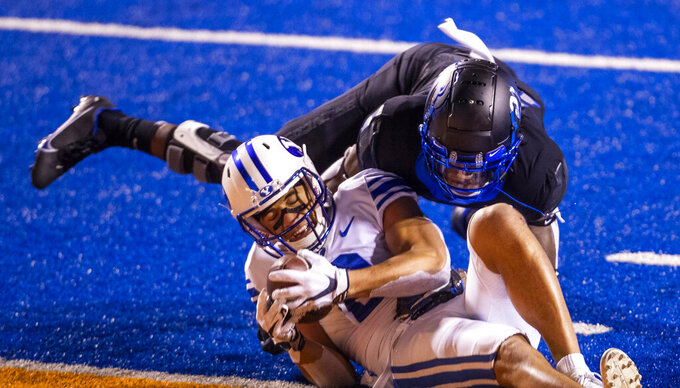 BYU wide receiver Neil Pau'u pushes across the goal line defended by Boise State safety Tyreque Jones (21) to score for the Cougars in the third quarter Friday, Nov. 6, 2020 at Albertsons Stadium in Boise. (Darin Oswald/Idaho Statesman via AP)