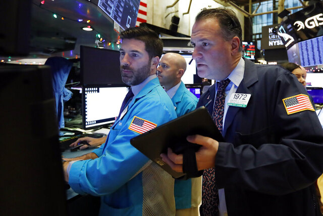 FILE - In this Dec. 11, 2019, file photo specialist Thomas McArdle, left, and trader Jonathan Corpina, right, work on the floor of the New York Stock Exchange. The U.S. stock market opens at 9:30 a.m. EST on Wednesday, Dec. 18. (AP Photo/Richard Drew, File)