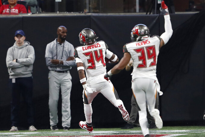 Tampa Bay Buccaneers safety Mike Edwards (34) runs into the end zone for a touchdown against the Atlanta Falcons during the second half of an NFL football game, Sunday, Nov. 24, 2019, in Atlanta. (AP Photo/John Bazemore)