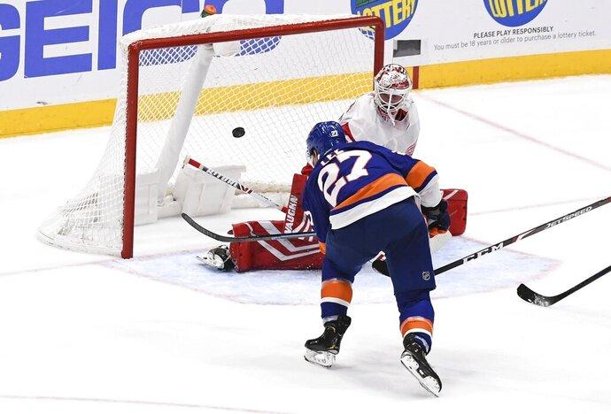 New York Islanders' Anders Lee (27) scores an overtime goal past Detroit Red Wings goaltender Jimmy Howard (35) during a preseason NHL hockey game Monday, Sept. 23, 2019, in Uniondale, N.Y. (AP Photo/Kathleen Malone-Van Dyke)