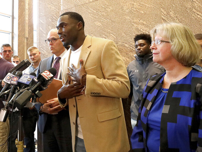 Former Wisconsin Badger football player Quintez Cephus speaks during a press conference to reiterate his request for reinstatement to the university in Madison, Wis. Monday, Aug. 12, 2019. The former wide receiver was acquitted earlier this month of sexual assault charges stemming from a campus incident in his apartment. He was expelled from the university in March after the university's own internal investigation. He is pictured with his attorneys, Stephen Meyer and Kathleen Stilling, as well as a group of current team members were on hand to show support for Cephus at the event. (John Hart/Wisconsin State Journal via AP)