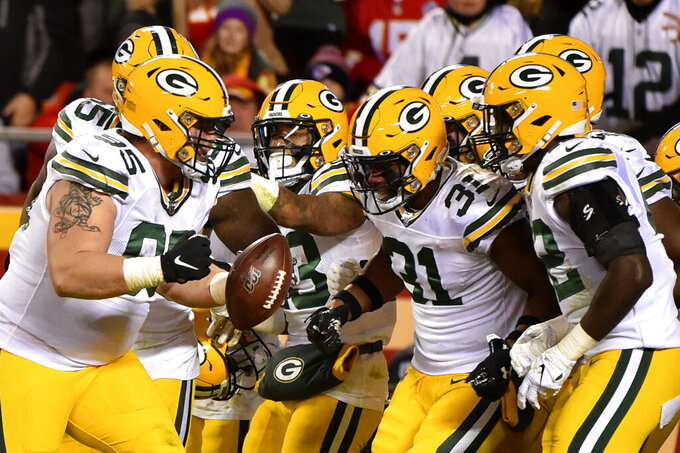 Green Bay Packers players celebrate with defensive lineman Tyler Lancaster (95), who recovered a ball fumbled by Kansas City Chiefs running back LeSean McCoy, during the second half of an NFL football game in Kansas City, Mo., Sunday, Oct. 27, 2019. (AP Photo/Ed Zurga)