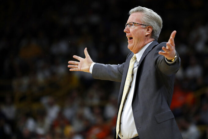 FILE - In this Jan. 20, 2019, file photo, Iowa head coach Fran McCaffery directs his team during the first half of an NCAA college basketball game against Illinois in Iowa City. Iowa has an interesting blend of potential and experience in its pipeline though, and the Hawkeyes could find themselves back in the NCAA Tournament if their revamped roster can jell ahead of Big Ten play. (AP Photo/Matthew Putney, File)