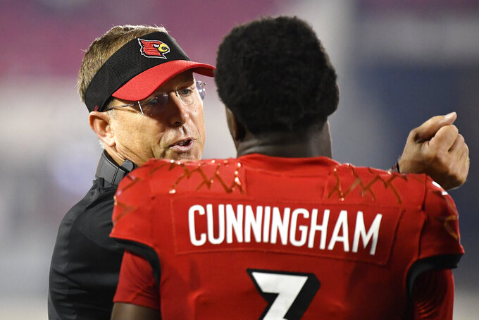 Louisville head coach Sott Satterfield, left, talks with quarterback Malik Cunningham (3) during the second half of an NCAA college football game against Eastern Kentucky in Louisville, Ky., Saturday, Sept. 11, 2021. (AP Photo/Timothy D. Easley)