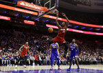 Miami Heat's Bam Adebayo (13) dunks the ball past Philadelphia 76ers' Jonathon Simmons (14) and Jonah Bolden (43) during the first half of an NBA basketball game Thursday, Feb. 21, 2019, in Philadelphia. (AP Photo/Matt Slocum)