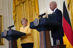 President Joe Biden and German Chancellor Angela Merkel conclude a news conference in the East Room of the White House in Washington, Thursday, July 15, 2021. (AP Photo/Susan Walsh)