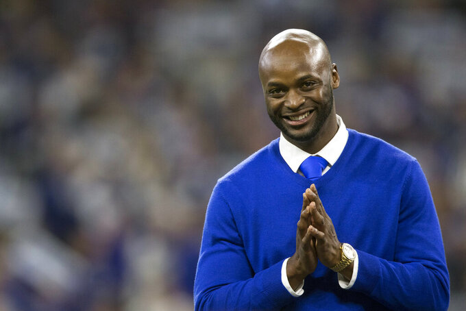 FILE - In this Nov. 18, 2018, file photo, former Indianapolis Colts wide receiver Reggie Wayne gestures during a Colts Ring of Honor ceremony during halftime of an NFL football game between the Colts and the Tennessee Titans in Indianapolis. Wayne is a 2021 finalist for entry into the Pro Football Hall of Fame. (AP Photo/AJ Mast, File)