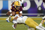 Arizona State quarterback Jayden Daniels (5) is sacked by UCLA defensive back Mo Osling III (7) during the first half of an NCAA college football game Saturday, Dec. 5, 2020, in Tempe, Ariz. (AP Photo/Matt York)