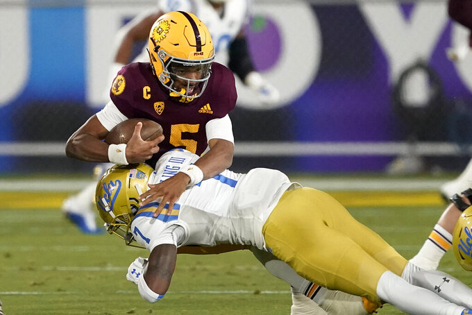 Arizona State quarterback Jayden Daniels (5) is sacked by UCLA defensive back Mo Osling III (7) during the first half of an NCAA college football game Saturday, Dec. 5, 2020, in Tempe, Ariz. (AP Photo/Matt York)