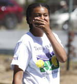 Aliyah Moon, 12 of Wilmington, reacts to an errant hit during the Tennis Rocks Tutoring and Music Association's last day of its summer session for young people at Haynes Park Thursday, Aug. 5, 2021, in Wilmington, Del. (William Bretzger/The News Journal via AP)