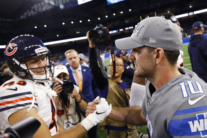Chicago Bears tight end Jesper Horsted (49) meets with Detroit Lions quarterback David Blough (10) after an NFL football game, Thursday, Nov. 28, 2019, in Detroit. (AP Photo/Rick Osentoski)