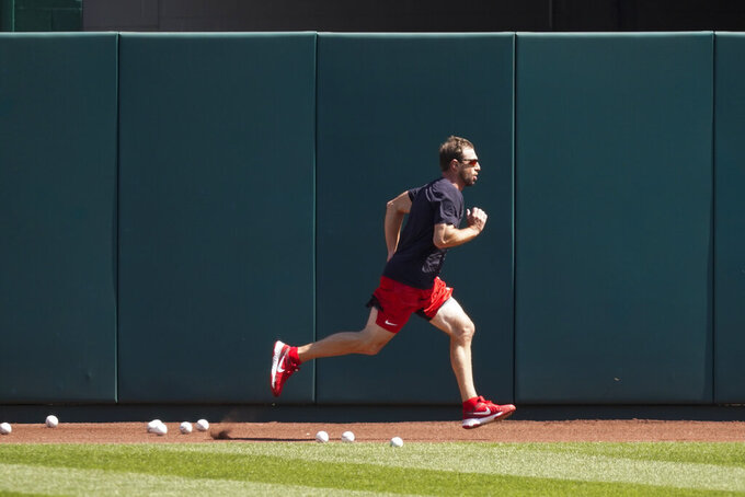Washington Nationals starting pitcher Max Scherzer runs during a baseball workout at Nationals Park, Monday, April 5, 2021, in Washington. The Nationals are scheduled to play the Braves on Tuesday. (AP Photo/Alex Brandon)
